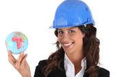 带头盔和世界各地的女人 — 图库照片