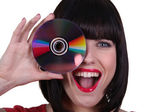 Alluring brunette with cd — Stock Photo