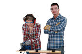 Couple using circular saw — Stock Photo