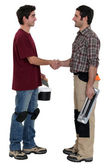 Workers shaking hands — Stock Photo