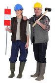 Craftsman and young apprentice posing together — Stock Photo