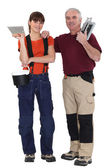A tiler and his apprentice. — Stock Photo