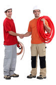 Craftsman and apprentice shaking hands — Stock Photo