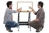 Father and son making wooden frame — Foto Stock