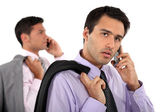Two businessmen making telephone calls — Stock Photo