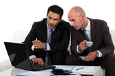 Business professionals discussing a report — Stock Photo