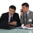 Two businessmen arguing at a desk — Stock Photo