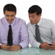 Two businessmen playing with their cell phones — Stock Photo #16850795