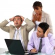 Three shocked business looking at results — Stock Photo