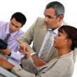Three colleagues in meeting — Stock Photo