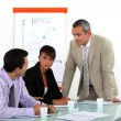 Businesswoman and male colleagues at meeting — Stock Photo