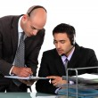 Office workers wearing headsets — Stock Photo #16852421