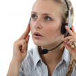 Young woman wearing headset — Stock Photo