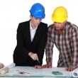 Two architects examining plans — Stock Photo #16855009