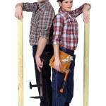 Handyman couple back to back — Stock Photo