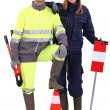 Construction crew with tools and warning signs — Stock Photo