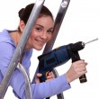 Woman with drill - Stock Photo