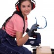 Young woman using miter saw — Stock Photo