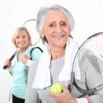 Two senior women doing tennis — Stock Photo #16857215