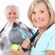 Stock Photo: Older women playing tennis