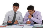 Business associates undertaking market research — Stock Photo