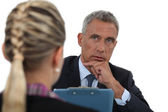 Businessman interviewing a young woman — Stock Photo