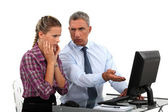 Employee having trouble with computer — Stock Photo