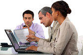 Three business in meeting — Stock Photo