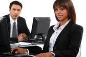 Man and woman taking a break from working to pose for the camera — Stock Photo