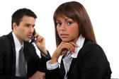 Two young businesspeople working together — Stock Photo