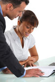 Business partners going over company accounts — Stock Photo