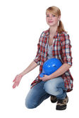 Female artisan kneeling and gesturing — Stock Photo
