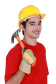 Young workman with a hammer — Stock Photo