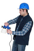 Man using paint sprayer — Stock Photo