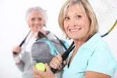 Older women playing tennis — Stock Photo