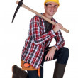 Young worker with a pickaxe — Stock Photo