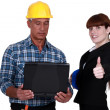 Enthusiastic engineer working with engineer — Stock Photo #16995457