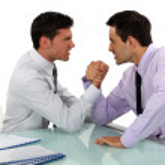 Two businessmen arm wrestling — Stock Photo