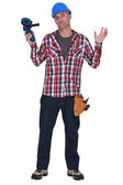 Confused manual worker holding angle grinder — Stock Photo