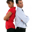 Couple standing back to back after quarrel — Stock Photo #17002573
