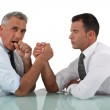 Businessmen doing arm wrestling — Stock Photo