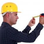 Man watching his measuring tape — Stock Photo