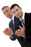 Empresários aplaudindo — Fotografia Stock