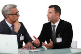 Business professionals having a discussion — Stock Photo