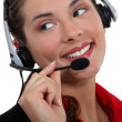 Portrait of a call center employee - Stock Photo