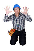 Tradesman pressing his hands against a see-through wall — Stock Photo