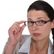 Stock Photo: Womadjusting her glasses