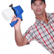 Man holding paint sprayer — Stock Photo