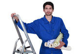 Decorator with step-ladder about to hang wallpaper — Stock Photo
