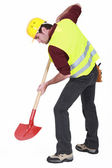 Worker digging with a shovel — Stock Photo